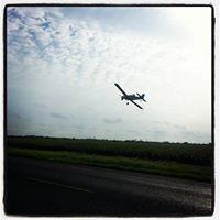 A crop duster sprays a field of sorghum near Rio Hondo, Texas